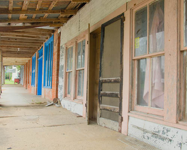 Abandoned shops along main street in the ghost town of Richards, Texas.