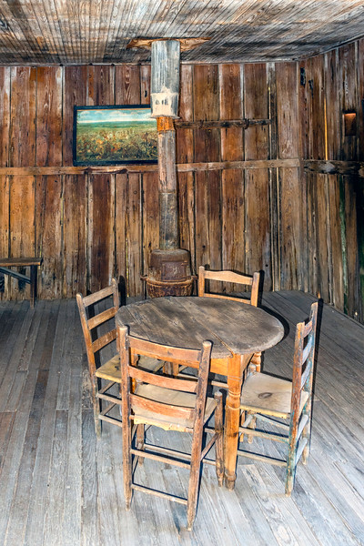 A card table stands alone in the Jersey Lilley saloon.<br /> Many an outlaw probably lost money here.