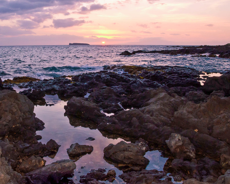 Sunset at Makena Beach from the island of Maui, Hawaii.  The top of the volcanic crater, Molokini, can be seen in the background.