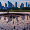 View of downtown Houston from atop the Police Officers Memorial, at sunrise.<br /> <br /> Names of some of the fallen can be seen in the foreground.<br /> <br /> Image 1 of 3.