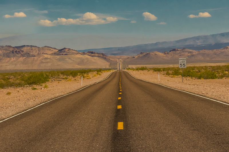 """The long and winding road heading out of Death Valley, toward Rhyolite Ghost Town.  This image was taken just before we approached the spot known as """"Area 51."""""""