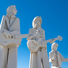36 foot tall sculptures of The Beatles , standing tall outside the David Adicke SculptrWorx Studio, in Houston, Texas.<br /> Beatles John Lennon, George Harrison, and drummer Ringo Starr, shown here.