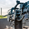 One of the anti-aircraft batteries on the battleship USS Texas<br /> Among US-built battleships, Texas is notable for her sizeable number of firsts: the first US Navy vessel to house a permanently assigned contingent of US Marines, the first US battleship to mount anti-aircraft guns, the first US ship to control gunfire with directors and range-keepers (analog forerunners of today's computers), the first US battleship to launch an aircraft,[10] from a platform on Turret, one of the first to receive the CXAM-1 version of CXAM production radar in the US Navy,the first US battleship to become a permanent museum ship,and the first battleship declared to be a US National Historic Landmark.