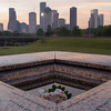 View of downtown Houston from atop the Police Officers Memorial, at sunrise.<br /> <br /> Names of some of the fallen can be seen in the foreground.<br /> <br /> Image 3 of 3.
