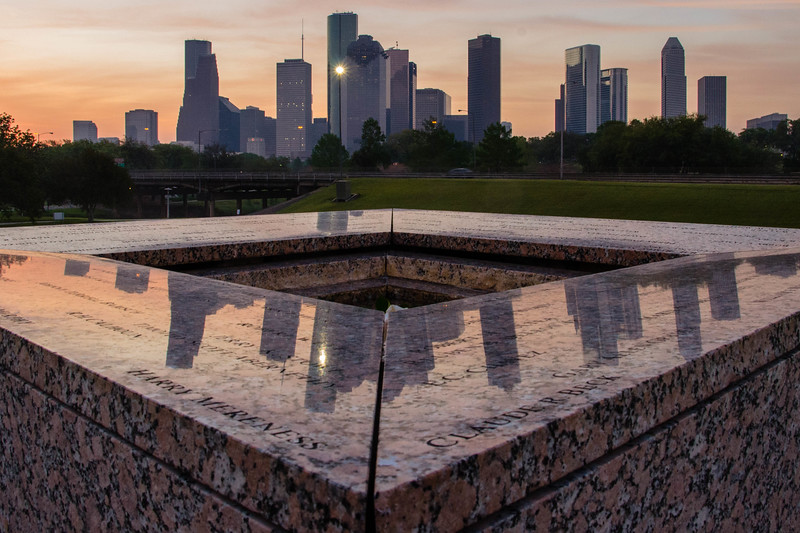 View of downtown Houston from atop the Police Officers Memorial, at sunrise.<br /> <br /> Names of some of the fallen can be seen in the foreground.<br /> <br /> Image 2 of 3.