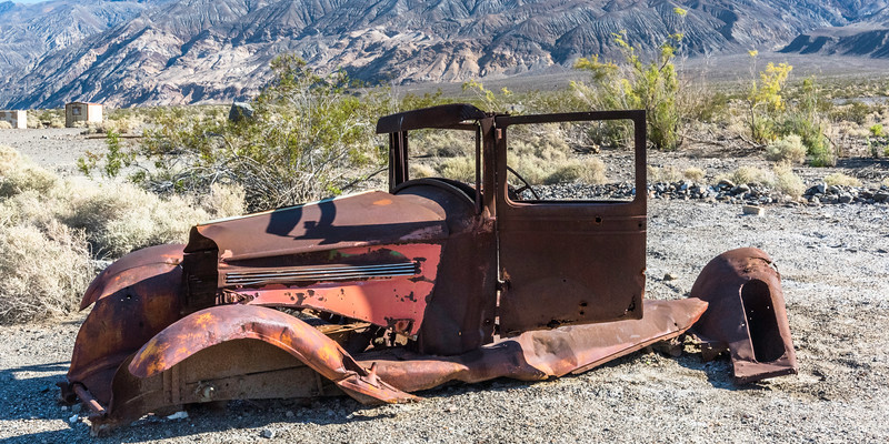 Remains of an old car at Ballarat ghost town, Death Valley.
