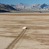 """Sailing Stone"" laying a path on the dry desert floor of the Racetrack Playa at Death Valley National Park"
