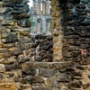 An old tower as seen through an old arch portal.<br /> Mission Espada, San Antonio Missions National Park, San Antonio, Texas