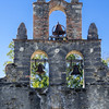 The bell tower atop the church, a popular site for weddings, as it was this day, at Mission Espada, San Antonio Missions National Historical Park, San Antonio, Texas