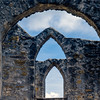 Window panes in stone.<br /> Mission San Jose in San Antonio, Texas