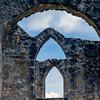 Window panes in stone.<br /> Mission San Jose in San Antonio, Texas