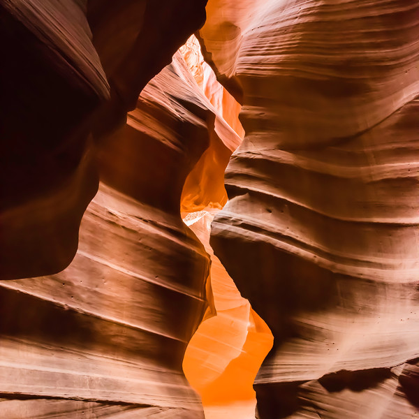 Antelope Canyon is a slot canyon in the American Southwest. It is located on Navajo land east of Page, Arizona. Antelope Canyon includes two separate, photogenic slot canyon sections, referred to individually as Upper Antelope Canyon or The Crack; and Antelope Canyon or The Corkscrew.