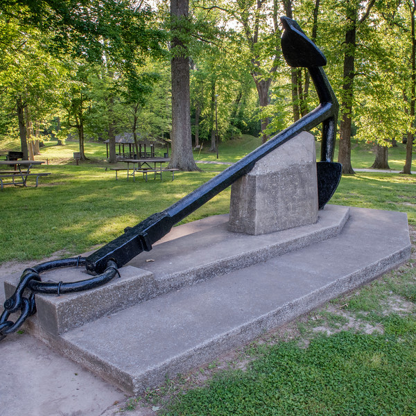 Polk's giant chain, which is estimated to have been over a mile long before flooding and erosion destroyed part of it. With an anchor weighing between four and six tons and each chain link being eleven inches (279 mm) long, the Civilian Conservation Corps built a stone monument to hold the chain in 1934.