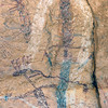 On the mural's left-hand side, can be seen a a wavy line shaped like an arch. This is believed to be Dawn Mountain, the final destination and the place where the sun rose for the first time.