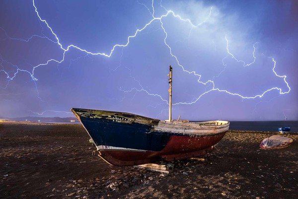 Storm over abandoned boats