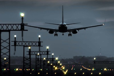 Plane landing at nightfall at an airport in Spain