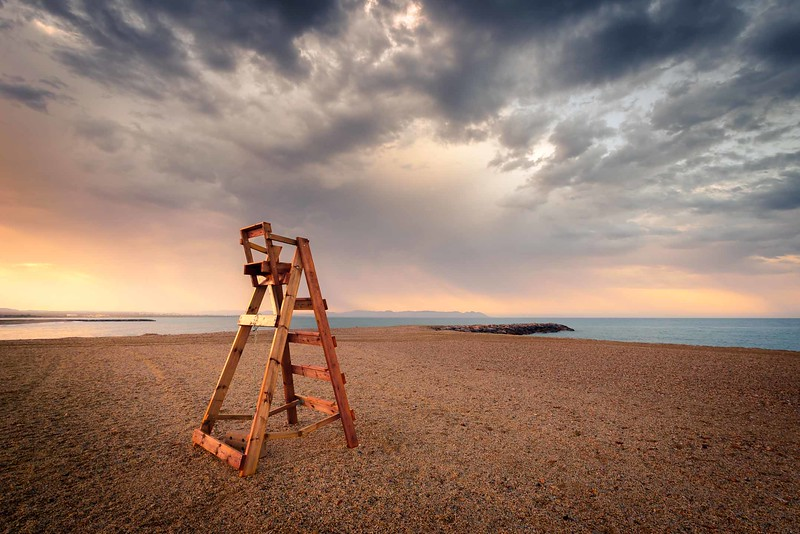 Empty lifeguard chair on the beach early in the day