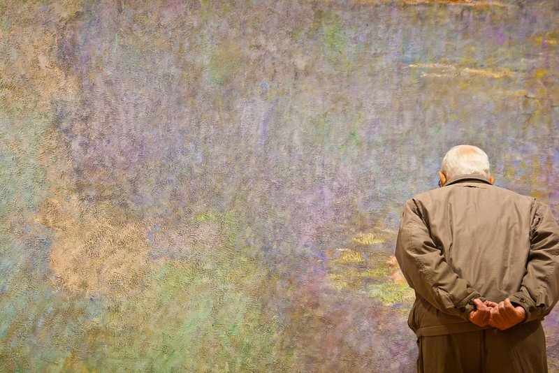 Man viewing a Monet painting at MOMA in New York