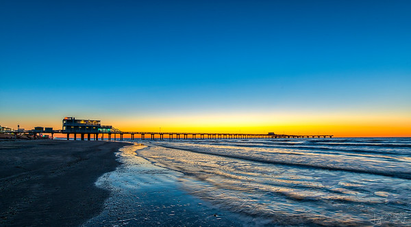 Dawn breaks at Jimmy's Fishing Pier on Galveston Island.