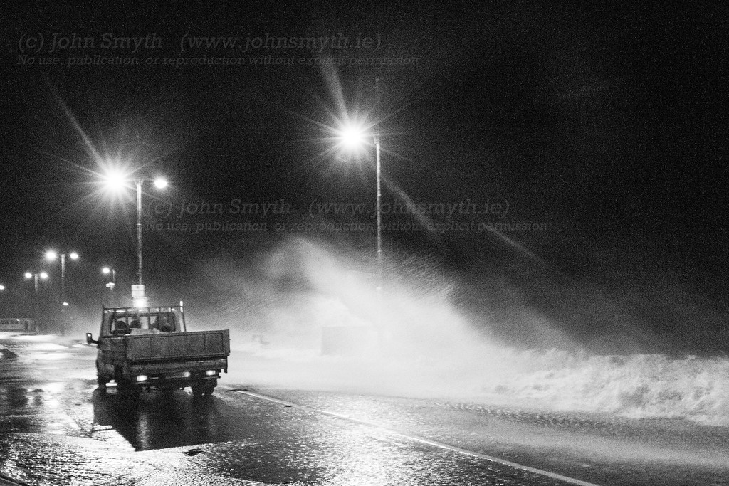 Waves washing over the Promenade as a council truck drives by - the Council were out in full force with sandbags, etc to minimize damage where possible.