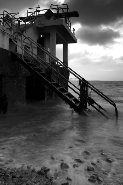The tide washes in at the Blackrock diving board on Salthill Promenade in Galway.