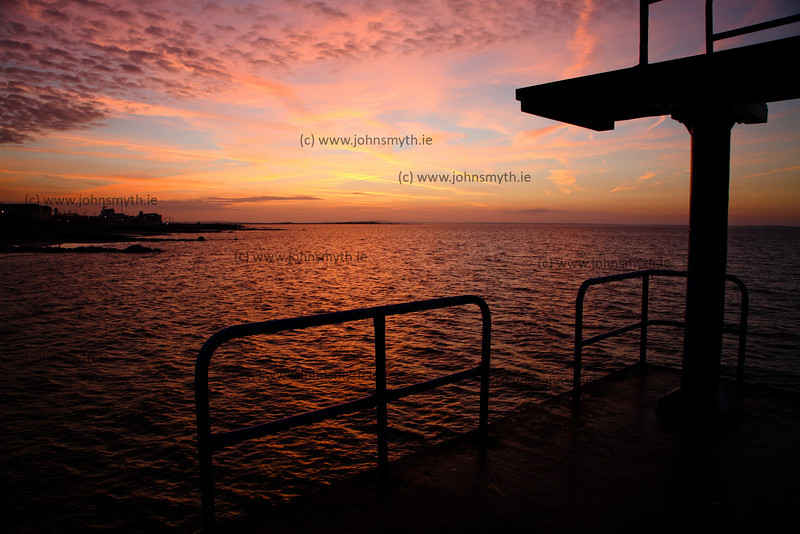 Sunrise over Salthill Promenade, seen from the Blackrock diving board .