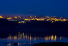 The lights of Knocknacarra reflected in Rusheen Bay, behind Silver Strand in Galway.