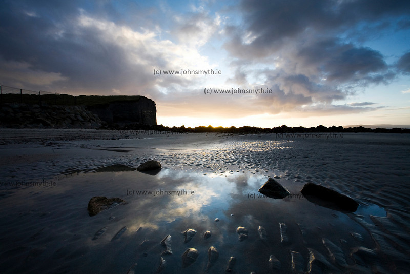 Sunrise at low tide on the beach at Silver Strand just west of Galway city in Ireland.