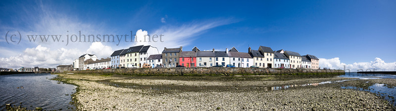 This is a panorama image of the Long Walk created by joining together about 15 images using Photoshop. The picture was taken at low tide. The panorama shows a distorted view - in reality, the row of houses form a straight line. To the right of the image is the mouth of the Corrib and Nimmo's Pier and to the left is Wolf Tone bridge.<br /> <br /> Because the image is much longer than it is tall, bear in mind that a print will have a lot of white space above and below the image.