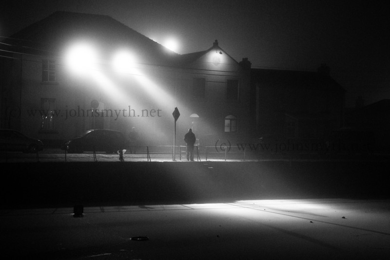 It was minus 7 degrees Celcius when I took this picture, back in January 2010. A freezing fog covered the Claddagh and a pair of spotlights created a pair of beams that just needed someone to walk into, to create the picture I wanted. The ice in the Claddagh Basin was thick enough to walk on (as a few foolhardy individuals proved that week)