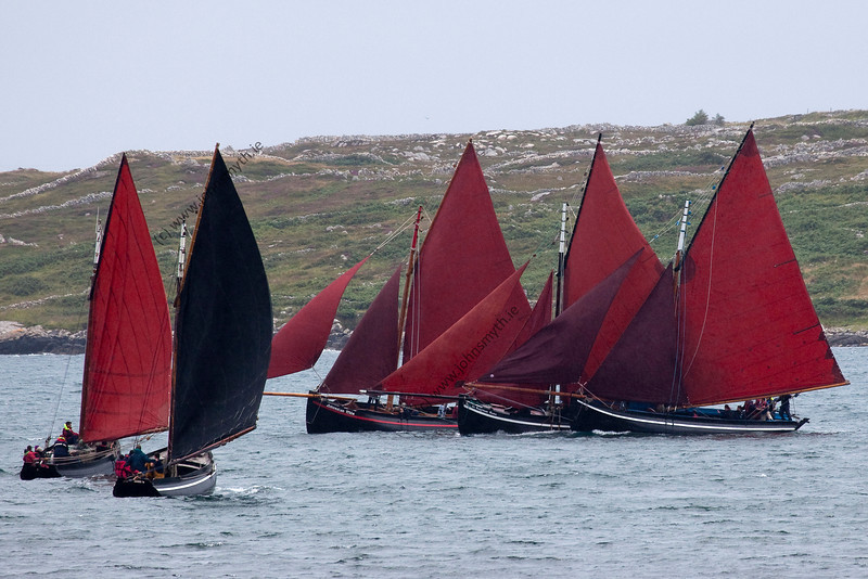 "There appeared to be a ""frank exchange of views"" as the three boats came very close to each other. There was no collision.<br />  Scene from the 2009 Feile an Doilin boat festival in An Cheathrú Rua (Carraroe) in Galway, Ireland."