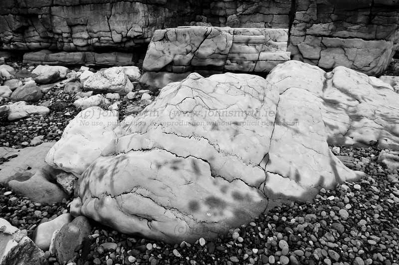 This picture isn't infrared - just monochrome. Even the original colour version was almost entirely composed of shades of grey, and the large rocks - worn smooth from the action of the sea - had a rather beguiling mottled pattern caused by the damp drying irregularly on the rock surface.