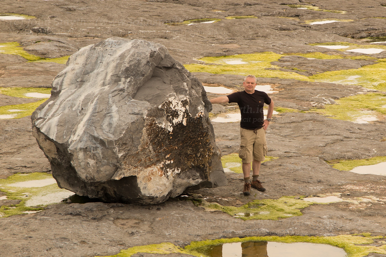This is a picture of me, standing beside a limestone boulder that has become dislodged from the cliff-face on Inis Mor (the largest of the Aran Islands).
