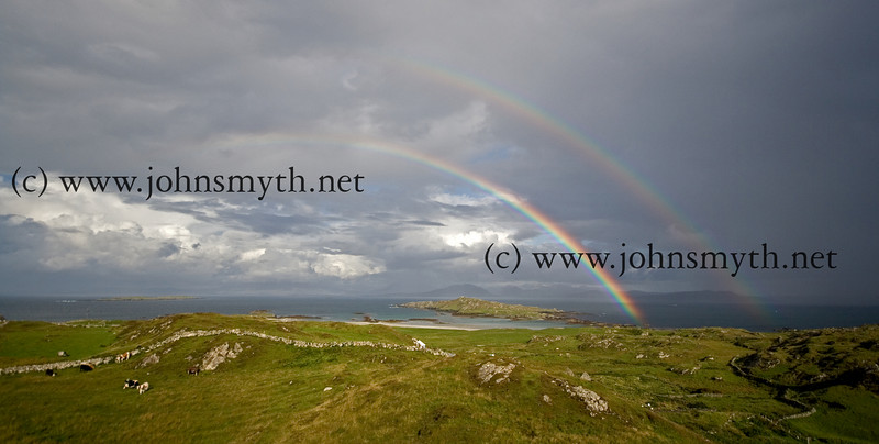 A double rainbow breaks over Inishbofin Island in the immediate aftermath of a downpour (not an uncommon occurrence!). The Mayo coastline is visible in the distance.