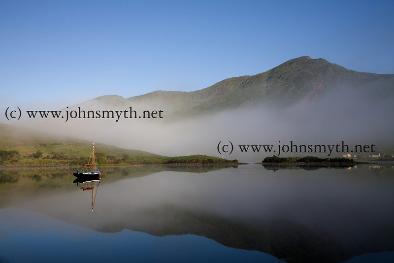 Early morning reflection near the source of Killary Harbour, Ireland's only fjord, which straddles the Galway / Mayo border. This picture was taken close to Aasleagh Falls during the summer 2007.