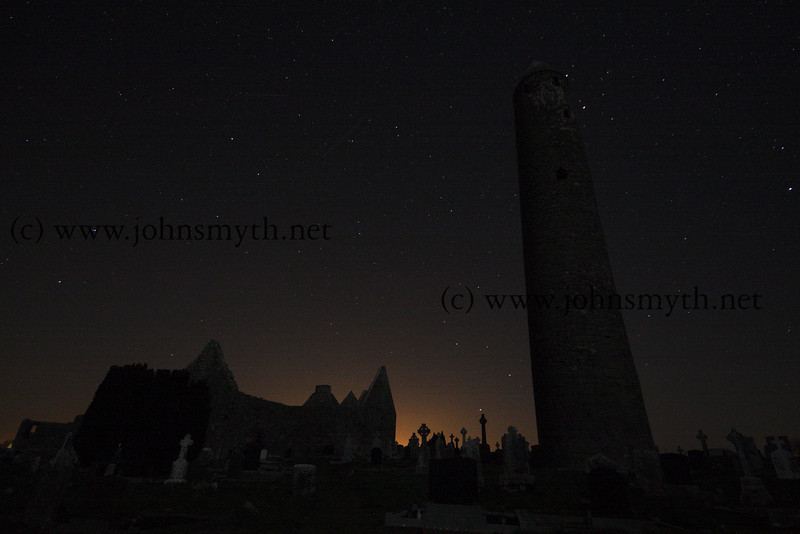 Kilmacduagh Round Tower illuminated by the stars (you can see The Plough) and the moon on a frosty winters night, near Gort in Galway.