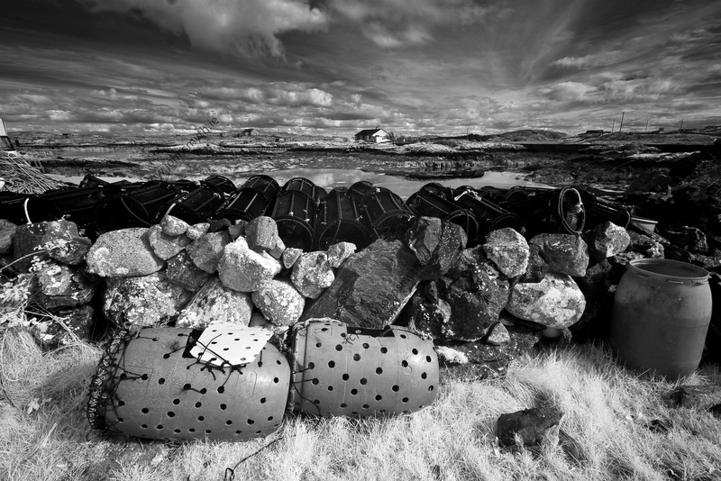 Lobster pots at a quay on Lettermore Island in Galway, Ireland.