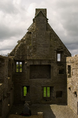 Interior view of Ross Errily friary, near Headford, Co. Galway. The massive fireplace on the second floor is clearly visible.