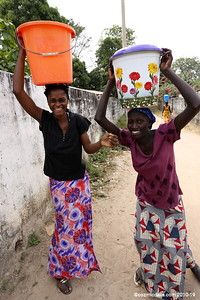 Ladies stop to say 'hello' on way home from the water well