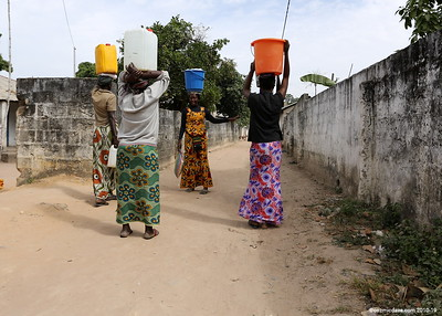 Ladies on the way home from the water well.