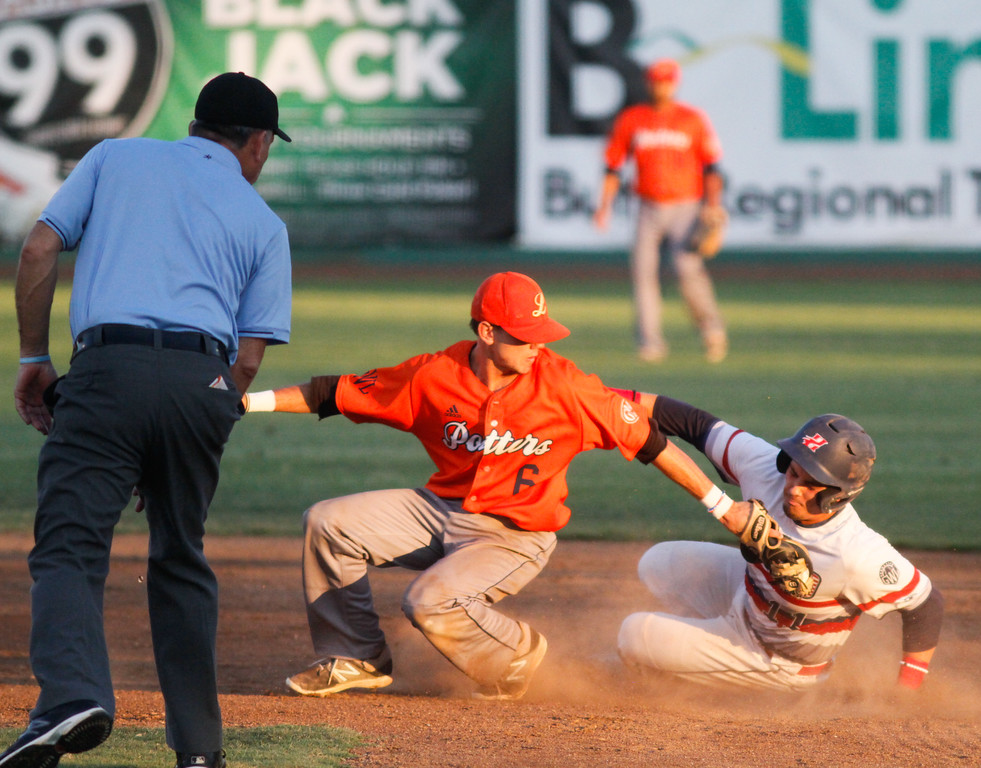 . Chico Heat\'s Brandon De La Guardia beats Lincoln Potters\'s Jake Boyd to second for a safe call from blue in a playoff game Wednesday August 9, 2017 at Nettleton Stadium in Chico, California. (Emily Bertolino -- Enterprise- Record)