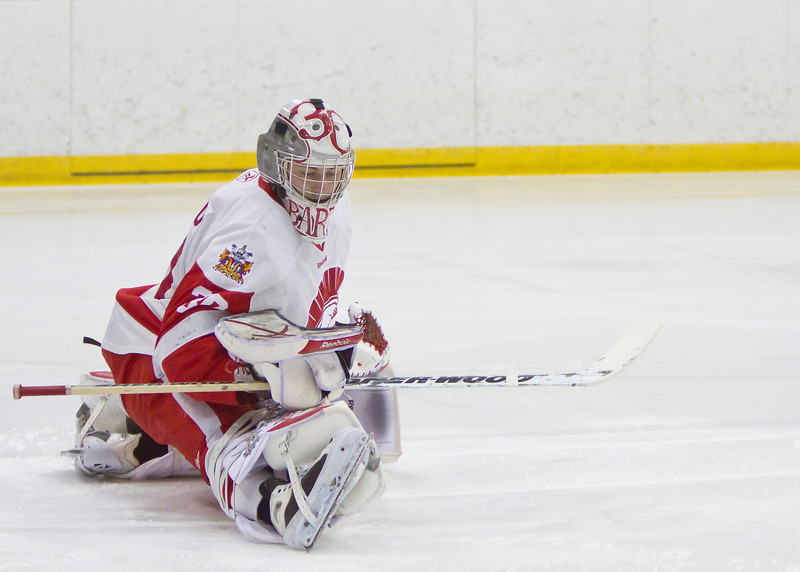 CALGARY(AB) February 24, 2012 - Trojans goalie #30 Adam Barko stretches during the pre-game skate.