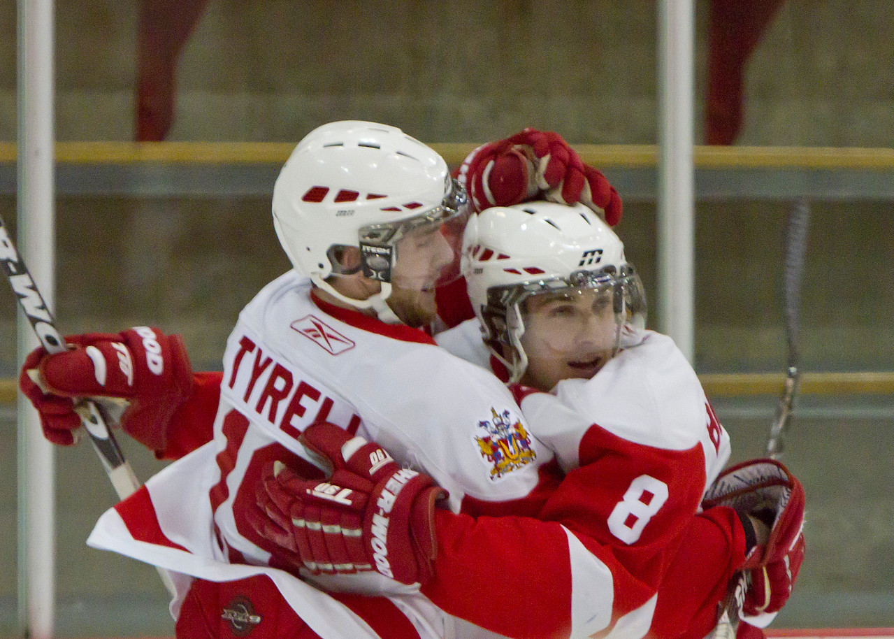 CALGARY(AB) February 24, 2012 - Trojans #19 Corey Tyrell and #8 Travis Bradshaw celebrate after a 1st period goal.