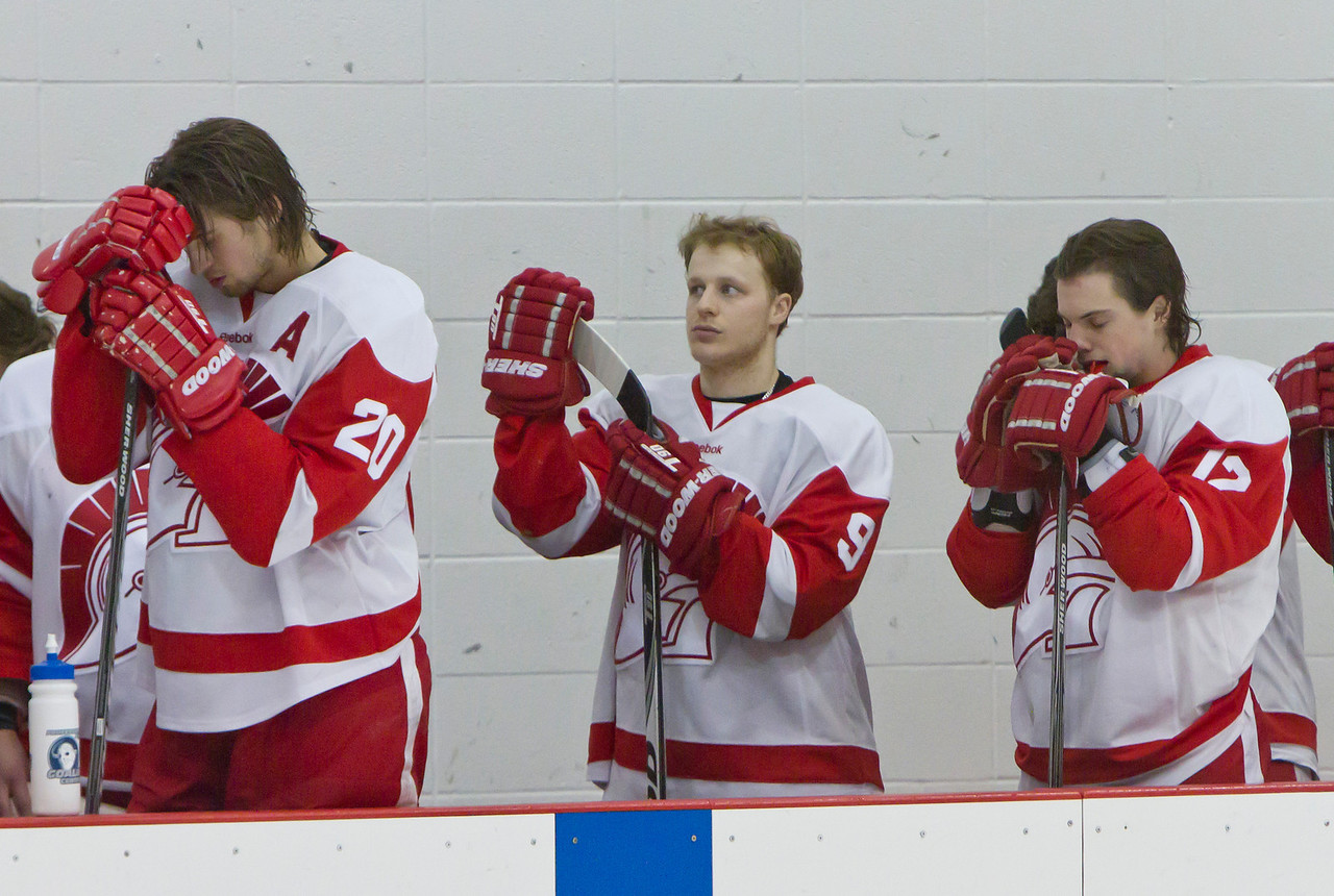 CALGARY(AB) February 24, 2012 -(from L to R) Trojans #20 Joel Woznikoski, #9 Nolan Souchotte and #12 Tyler French during the national anthem.