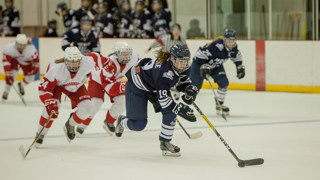 CALGARY(AB) September 10, 2016 - Women's hockey game action between the host team SAIT Trojans (white) and the MRU Cougars (blue).