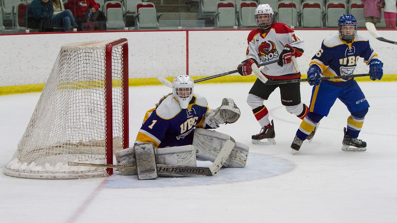 CALGARY(AB) October 16, 2015 - Thunderbird's goalie Samantha Langford (#1), Mikayla Ogrodniczuk (#16) and Dino's forward Sydney Mullin (#16) watch the play late in third period action.