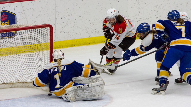 CALGARY(AB) October 16, 2015 - The initial shot somehow found it's way through Thunderbird's goalie Samantha Langford (#1) left side and briefly danced outside the goal line before being smothered, taking away any second period scoring chance for Dinos's forward Heather Berzins (#14).