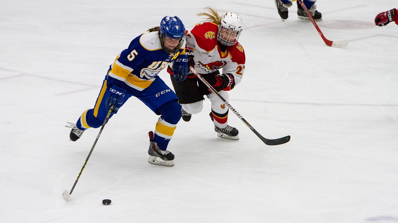 CALGARY(AB) October 16, 2015 - On defense for the Thunderbird's, Kelly Murray (#5) and Dino's forward Rylee Smith (#27) scramble as play is carried out of the Thunderbird's zone.