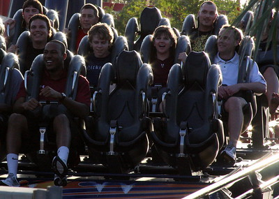 USC SID  Steve Fink rides with his family and Asst. SID Andrew Kitick