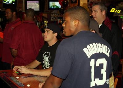 Brian Maddox and Rev. Adrian Despres watch Chris Smelley